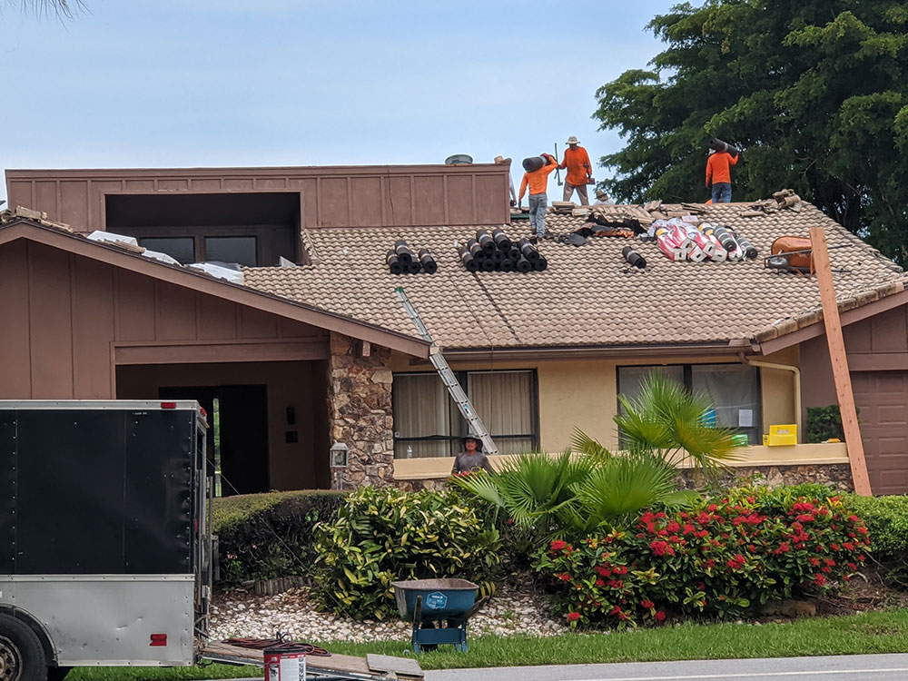 Close permits on roof in Boca Raton